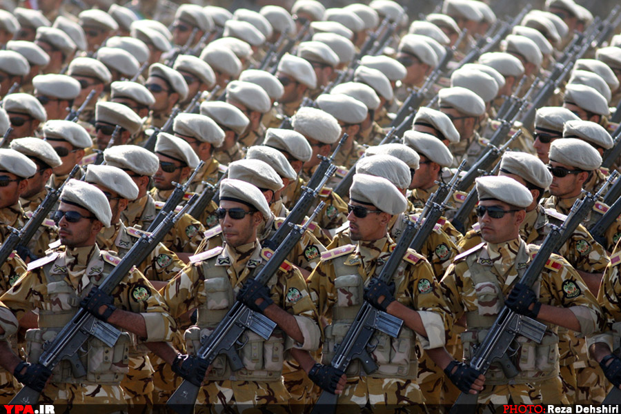 Islamic Republic of Iran Army soldiers marching in front of highest-ranking commanders of Armed Forces of the Islamic Republic of Iran during Sacred Defence Week parade.