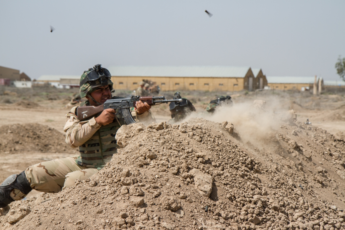 Iraqi soldiers trained with members of the 3rd Brigade Combat Team, 82nd Airborne Division, at Camp Taji, Iraq. The 3rd Bde., 82nd Abn. Div., was deployed to Iraq as part of Combined Joint Task Force - Operation Inherent Resolve to advise and assist Iraqi Security Forces in their fight against the Islamic State of Iraq and the Levant. Iraqi soldiers learned tactics and techniques from U.S. Soldiers during a six-week basic training course, and more complicated tactics during a three-week advanced training course. (U.S. Army photo by Sgt. Cody Quinn, CJTF - OIR Public Affairs)