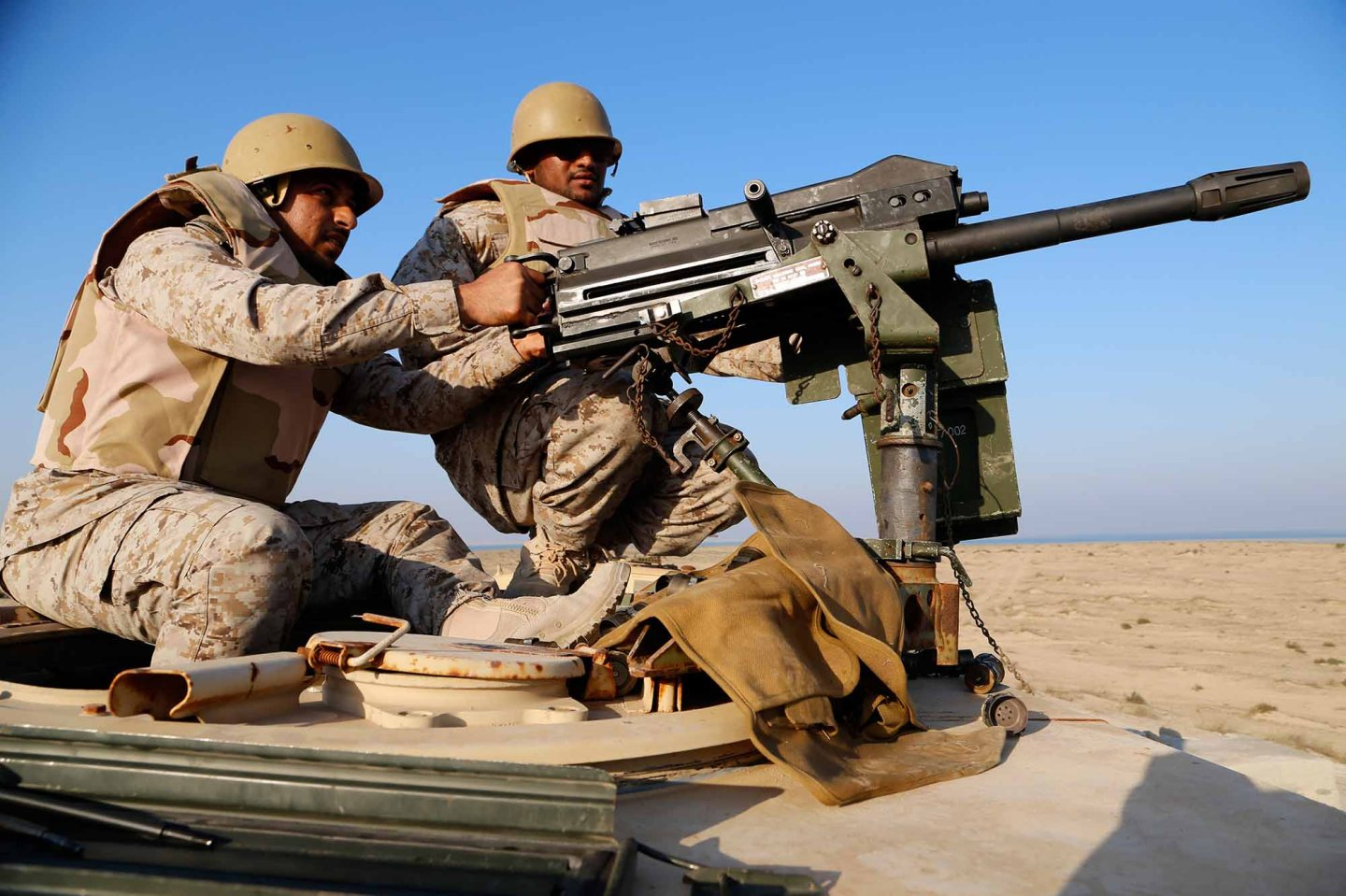 5TH FLEET AREA OF RESPONSIBILITY (Dec. 11, 2014) A Saudi Marine fires an Mk19 grenade launcher during a joint machinegun live-fire exercise with U.S. Marines from Echo Company, Battalion Landing Team 2nd Battalion, 1st Marines, 11th Marine Expeditionary Unit (MEU), as part of exercise Red Reef 15 in the U.S. 5th Fleet area of responsibility, Dec. 11, 2014. Red Reef, is part of a routine theater security cooperation engagement plan between the U.S. Navy, U.S. Marine Corps and Royal Saudi Naval Forces that serves as an excellent opportunity to strengthen tactical proficiency in critical mission areas and support long-term regional security.