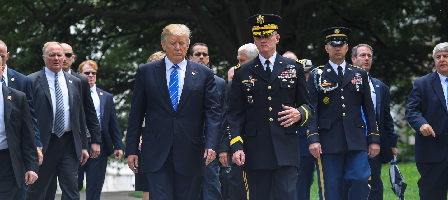 President Donald J. Trump and U.S. Army Maj. Gen. Michael L. Howard, the commander of Joint Force Headquarters - National Capitol Region and U.S. Army Military District of Washington, depart from Arlington National Cemetery, in Arlington, Va., May 29, 2017, after participating in a wreath laying ceremony honoring Memorial Day. (U.S. Army photo by Zane Ecklund) Unit: Army Photo DVIDS Tags: POTUS; Memorial Day; Arlington National Cemetery; military; President Trump