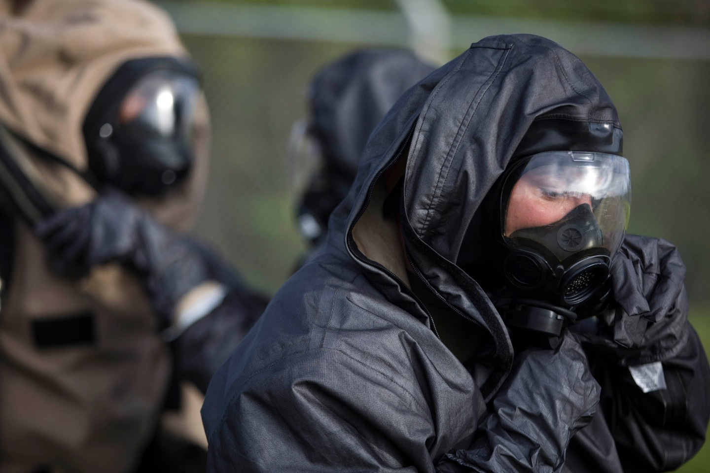 U.S. Marine, Chemical Biological Radiological Nuclear (CBRN) Defense Specialists from the 31st Marine Expeditionary Unit conduct a training exercise on Camp Hansen, Okinawa, Japan, July 30, 2014. CBRN's mission is to locate, test and contain hazardous materials or gasses to further protect U.S. Forces. (U.S. Marine Corps Photo by Lance Cpl. Brian Bekkala/ Released)