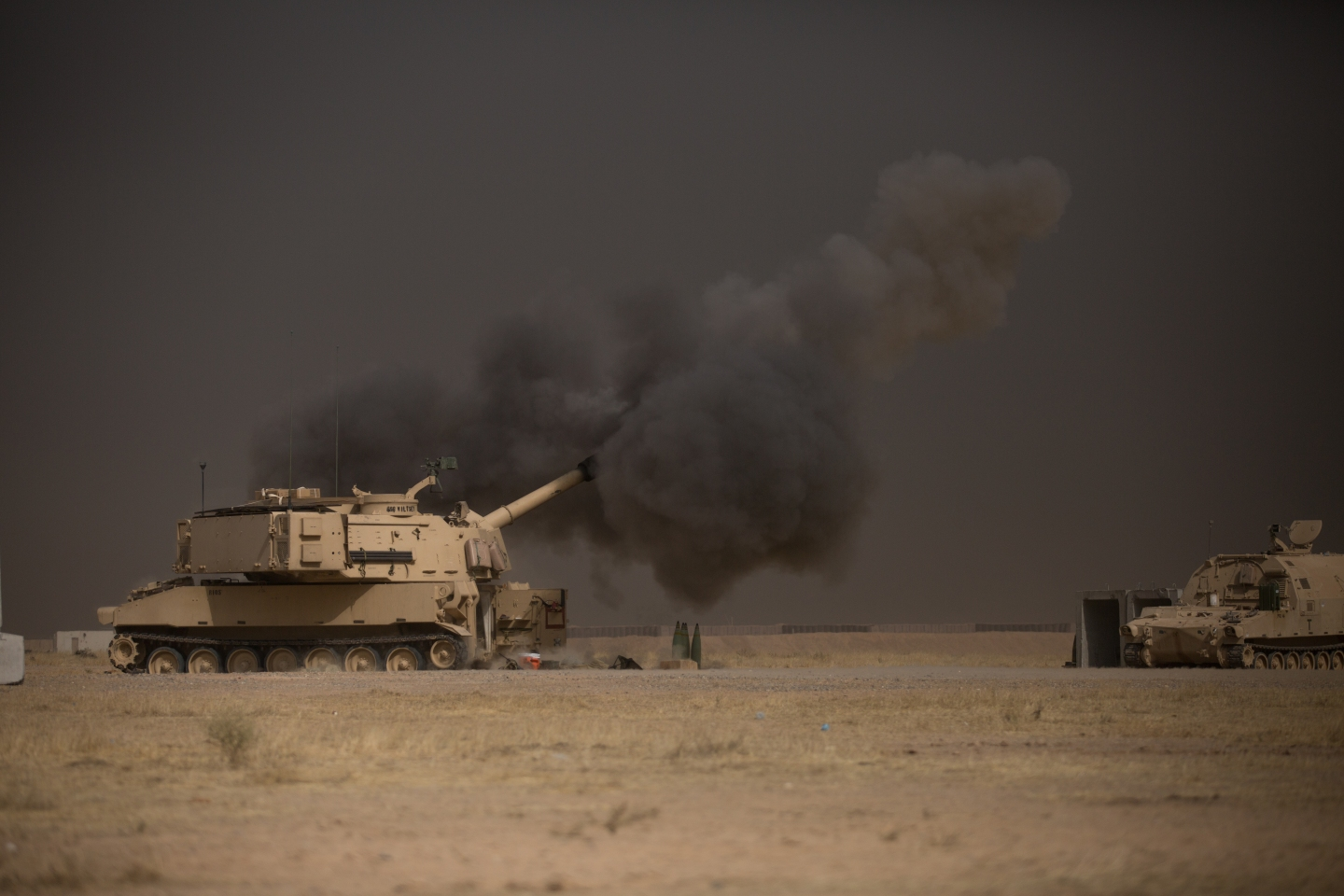 A U.S. Army M109A6 Paladin conducts a fire mission at Qayyarah West, Iraq, in support of the Iraqi security forcesâ push toward Mosul, Oct. 17, 2016. The support provided by the Paladin teams denies the Islamic State of Iraq and the Levant safe havens while providing the ISF with vital artillery capabilities during their advance. The United States stands with a Coalition of more than 60 international partners to assist and support the Iraqi security forces to degrade and defeat ISIL. (U.S. Army photo by Spc. Christopher Brecht)