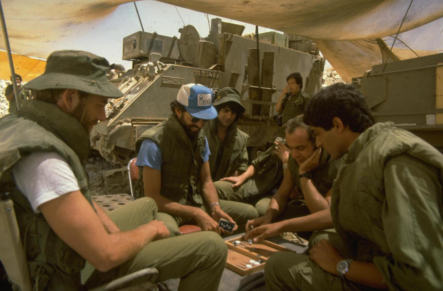 Members of 155 mm mobile gun crew play backgammon during a lull outside Beirut.