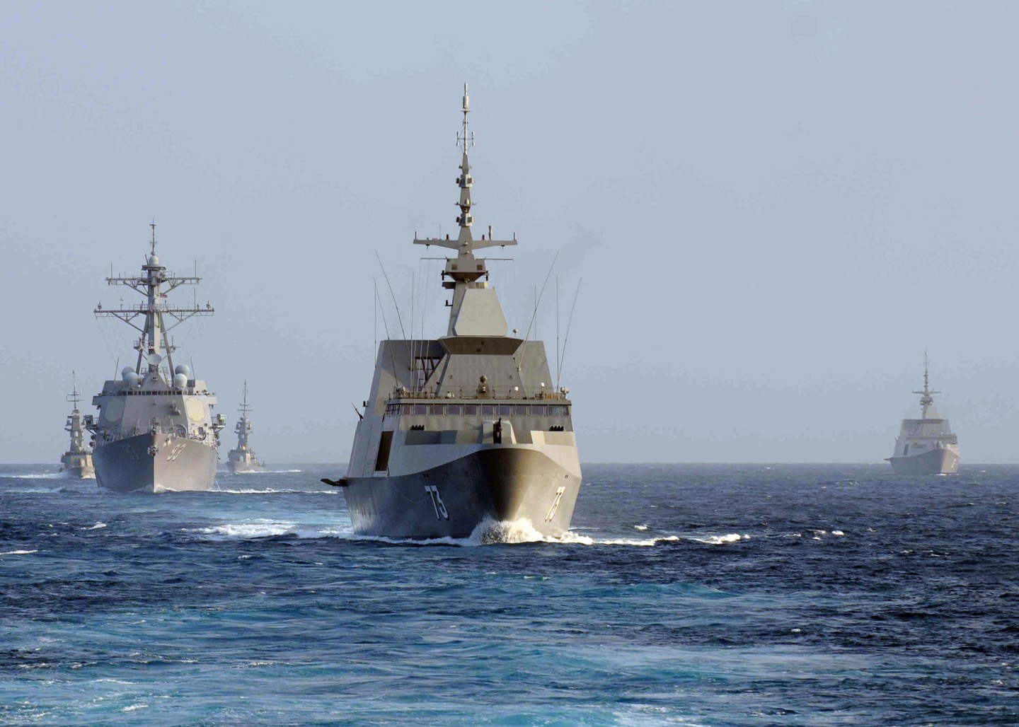 The Singapore Navy frigate RSS Supreme (FFG 73), center, leads the guided missile destroyer USS Chung-Hoon (DDG 93), left, and the Singapore Navy corvette RSS Vigour (92) during maneuvers in the South China Sea Aug. 23, 2011. The ships were participating in Cooperation Afloat Readiness and Training Singapore (CARAT) 2011. CARAT is a series of bilateral exercises held annually in Southeast Asia to strengthen relationships and enhance force readiness. (DoD photo by Mass Communication Specialist 3rd Class Andrew Smith, U.S. Navy/Released)