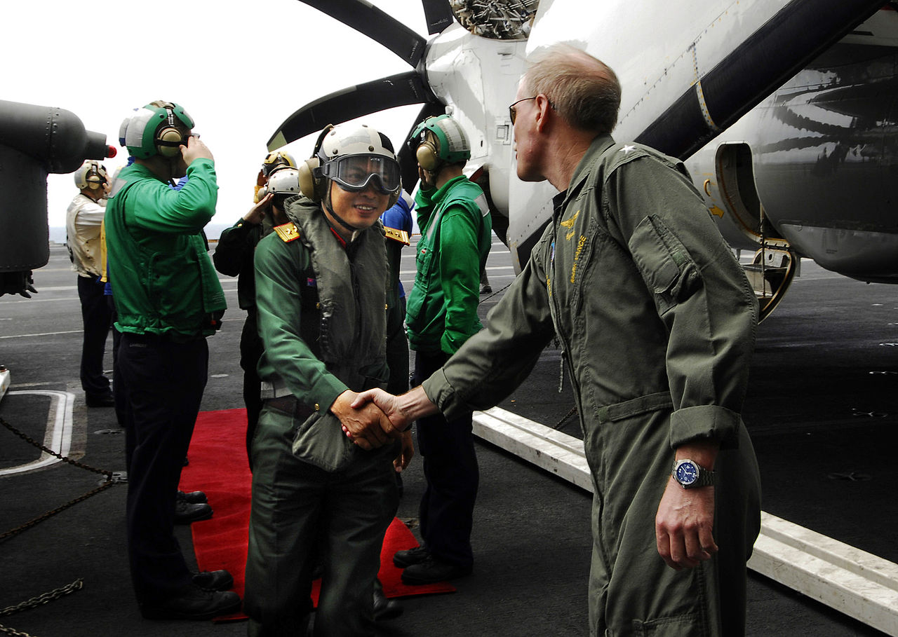 PACIFIC OCEAN (April 22, 2009) Rear Adm. Mark Vance, commander, Carrier Strike Group Three, welcomes Senior Col. Do Minh Tuan, Deputy Chief of Staff for the Vietnam People's Armed Forces Air Defense Force, aboard the aircraft carrier USS John C. Stennis (CVN 74). Stennis and Carrier Air Wing (CVW) 9 are on a scheduled six-month deployment to the western Pacific Ocean