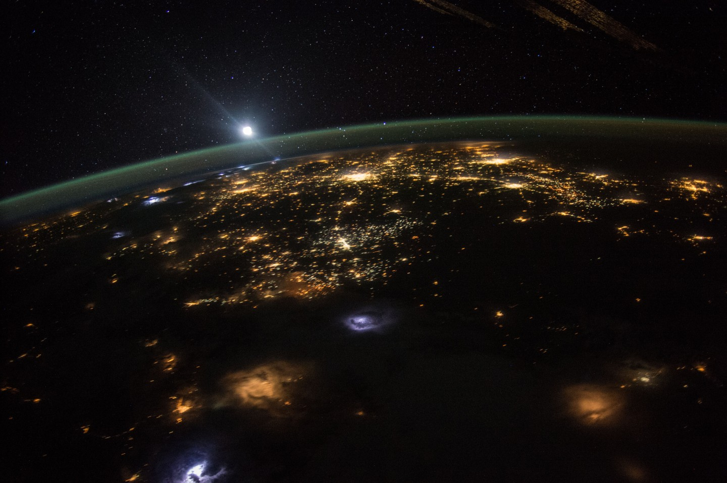 NASA astronaut Scott Kelly took this photograph of a moonrise over the western united states.