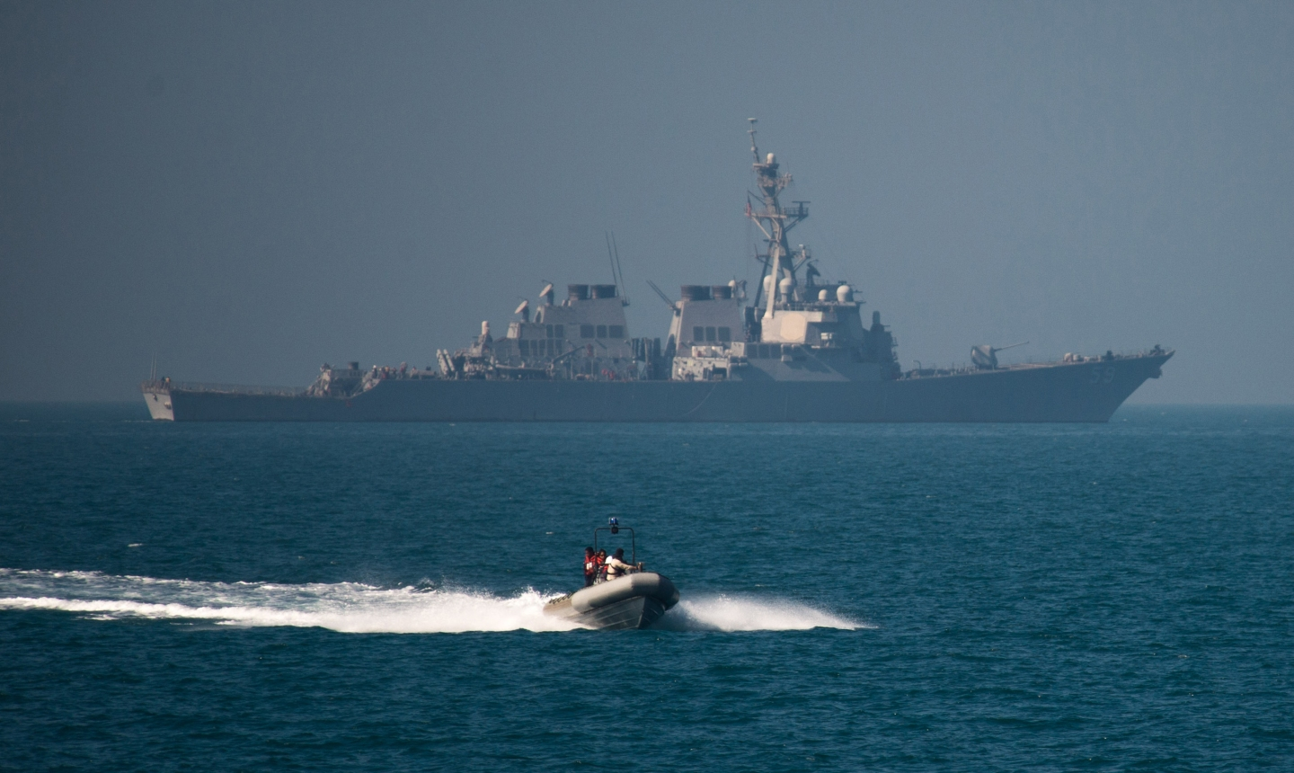 A ridged hull inflatable boat, launched from the Raleigh Burke-class guided-missile destroyer USS Russell (DDG 59), participates in a monthly Iraqi bilateral exercise. The Iraqi bilateral is a monthly exercise with U.S. Navy, U.S. Coast Guard, and the Iraqi navy. The U.S. participates in bilateral exercises with partner nations in order to build and strengthen solid partnerships throughout the region. Commander, Task Force 55 controls surface forces including U.S. Navy coastal patrol craft and U.S Coast Guard patrols boats in the U.S. 5th Fleet area of operations. (U.S. Navy Combat Camera photo by Mass Communication Specialist 2nd Class Torrey W. Lee/Released)160214-N-CJ186-187